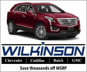 Logo for Wilkinson Cadillac Sanford NC. Features a mid-size SUV.