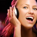 A woman wearing headphones, enjoying the music being played.